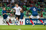Maximilian Dittgen of Germany is challanged by Seko Fofana of France during the UEFA U-17 European Championship final tournament group match between Germany and France at the SRC Stozice Stadium in Ljubljana, Slovenia, May 10, 2012.