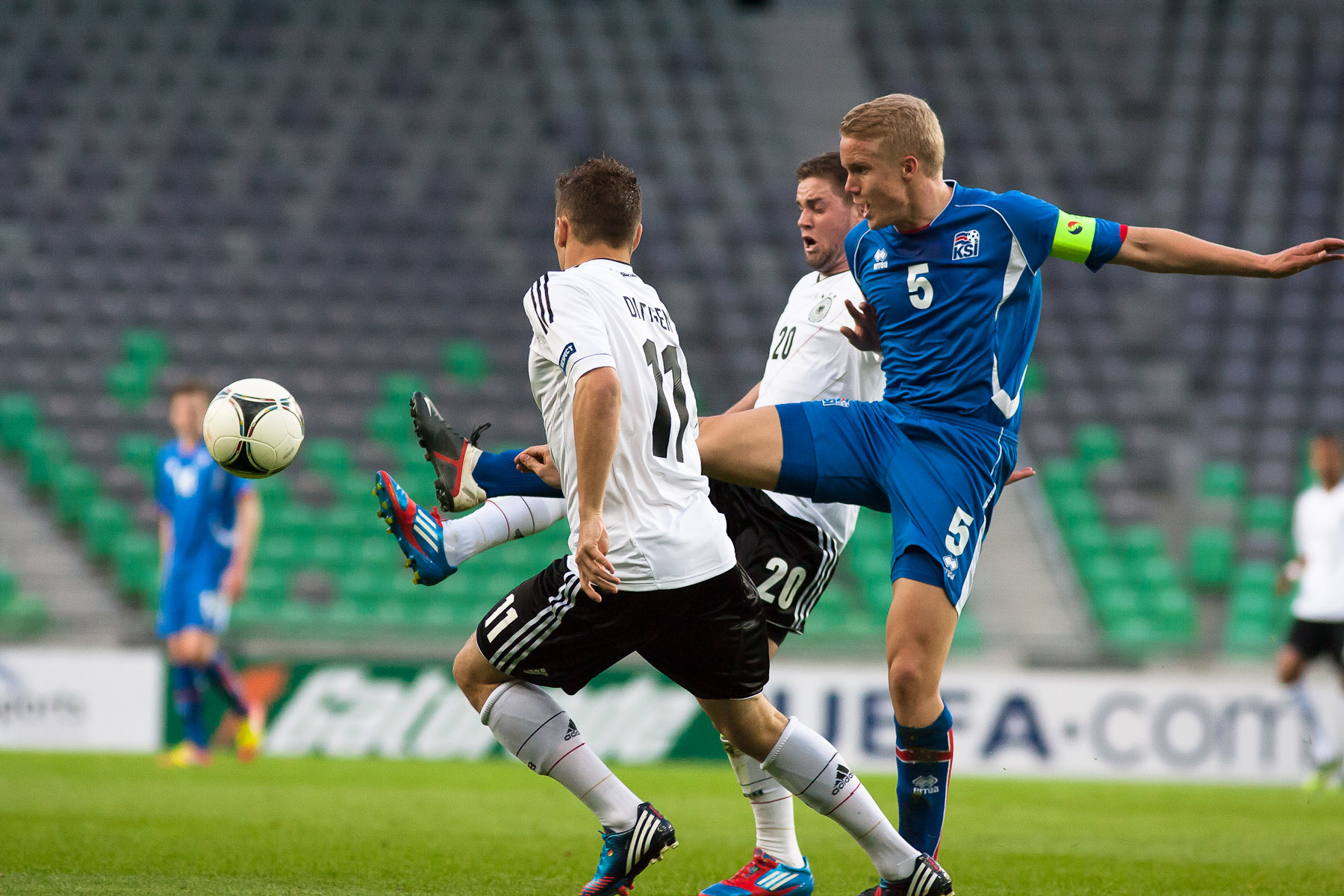 Hjortur Hermannsson of Iceland is challanged by Maximilian Dittgen and Marc Stendera of Germany during the UEFA U-17 European Championship final tournament group match between Germany and Iceland at the SRC Stozice Stadium in Ljubljana, Slovenia, May 7, 2012.