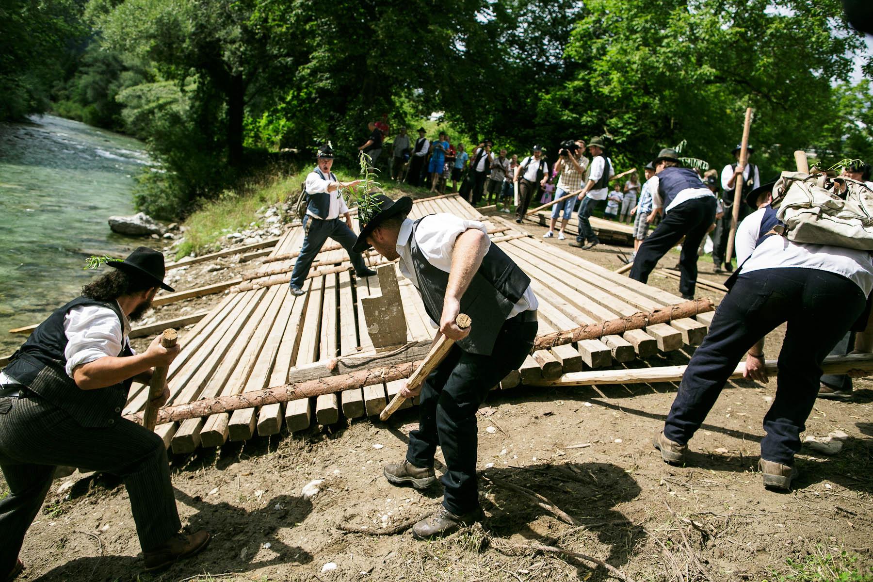Raftsmen launch a raft into Savinja river during the 55th Raftsmen Ball in Ljubno ob Savinji, Slovenia.