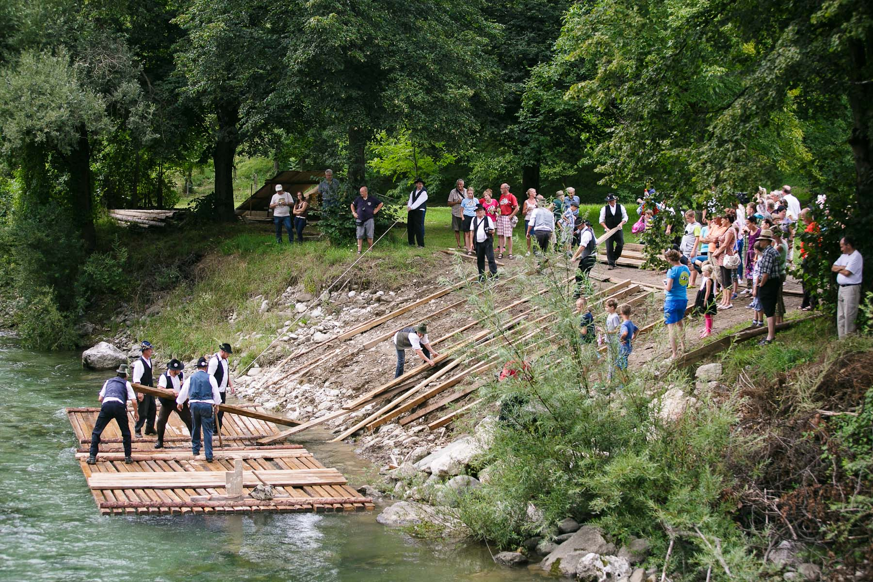 Raftsmen launch a raft into Savinja river during the 55th Raftsmen Ball in Ljubno ob Savinji, Slovenia.