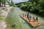 Raftsmen navigate a traditional raft down the Savinja river during the 55th Raftsmen Ball in Ljubno ob Savinji, Slovenia.
