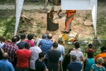 Visitors watch a competition in chainsaw sculpturing during the 55th Raftsmen Ball in Ljubno ob Savinji, Slovenia.