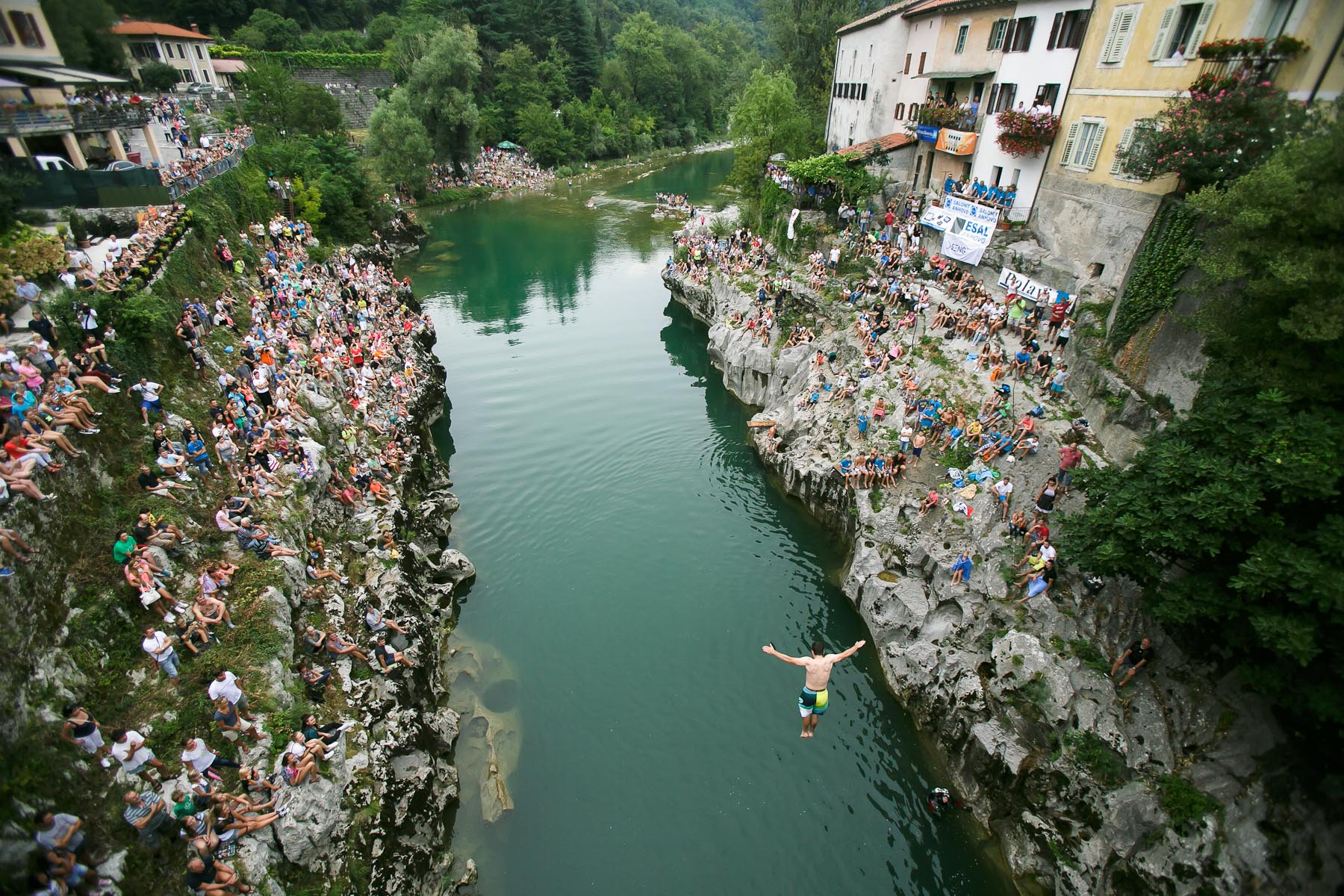 A competitor dives from a bridge over river Soca during an annual diving competition in Kanal, Slovenia, August 16, 2015.