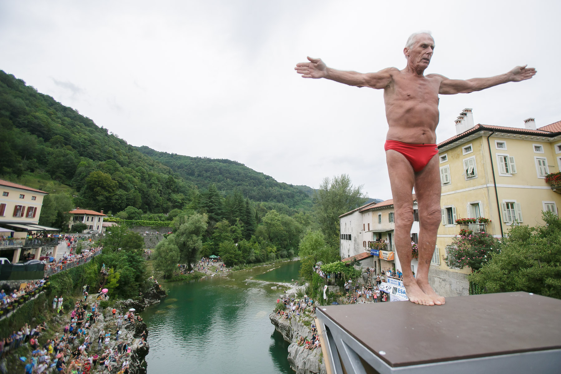 77-year old Pino Auber from Trieste, Italy, prepares to dive from a bridge over river Soca during the annual diving competition in Kanal, Slovenia, August 16, 2015.