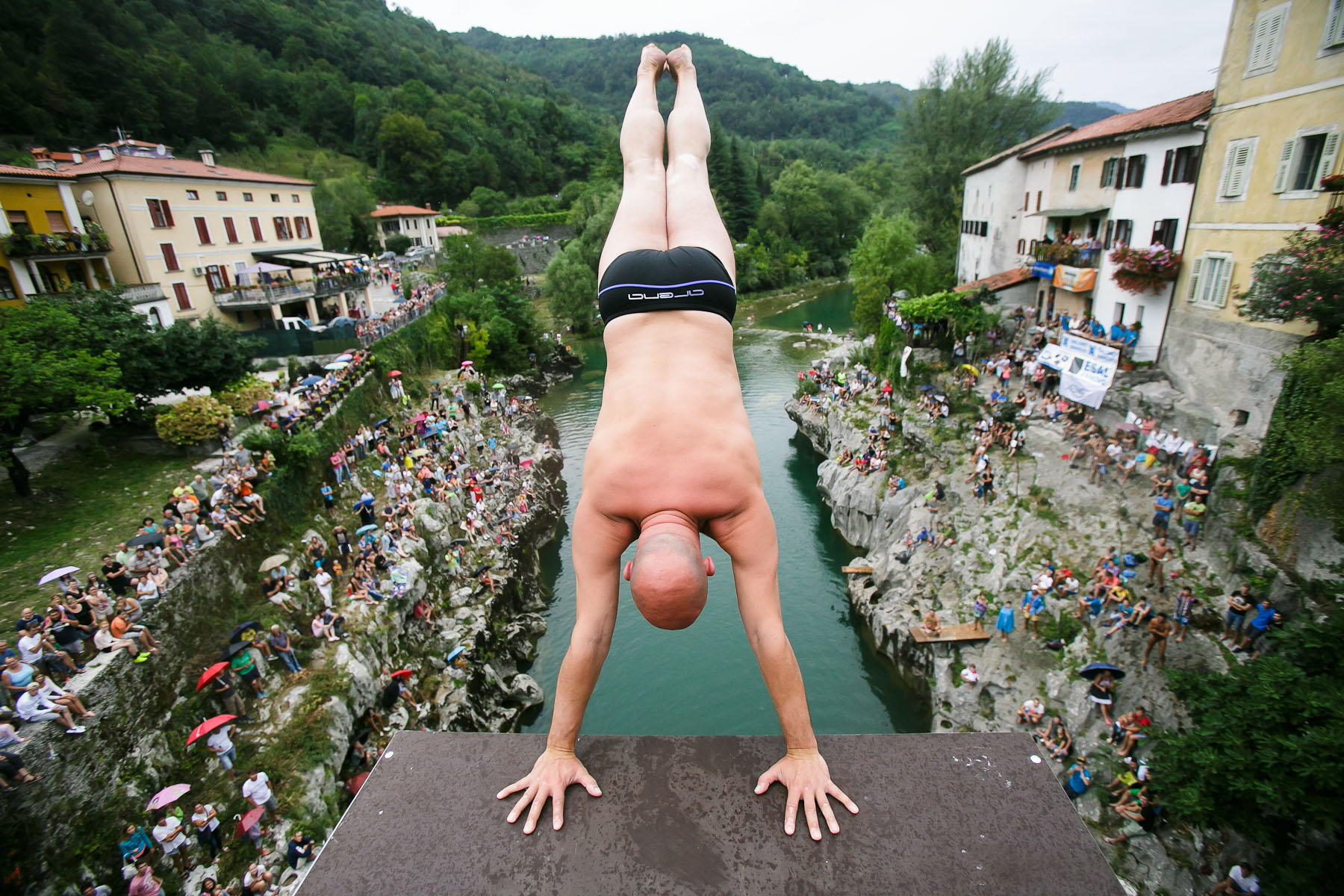 A competitor prepares to dive from a bridge over river Soca during an annual diving competition in Kanal, Slovenia, August 16, 2015.