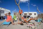 France,Juillet 2014. La plage de Piémenson à l'embouchure du Rhône est la dernière plage en Europe où le camping sauvage est toléré. Les deux grandes communautées présentes sont les naturistes, très soucieux de l'environnement et passés maîtres dans l'art de la construction de cabanons en bois flotté, et les {quote}textiles{quote} vivant plutôt dans des caravanes.