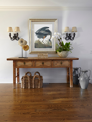 beach house foyer with console, art and wall sconces
