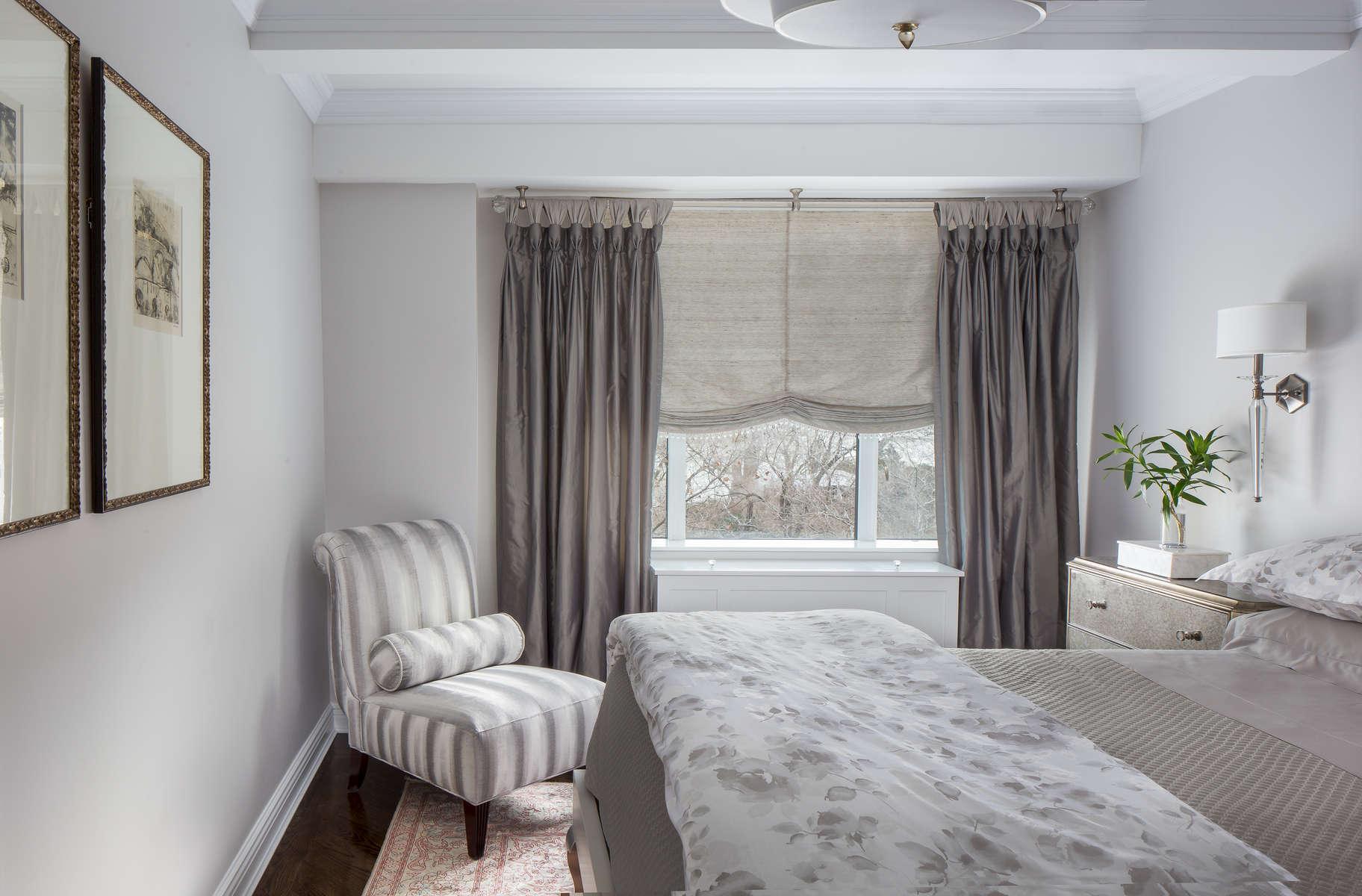 grey room with diamond tufted headboard