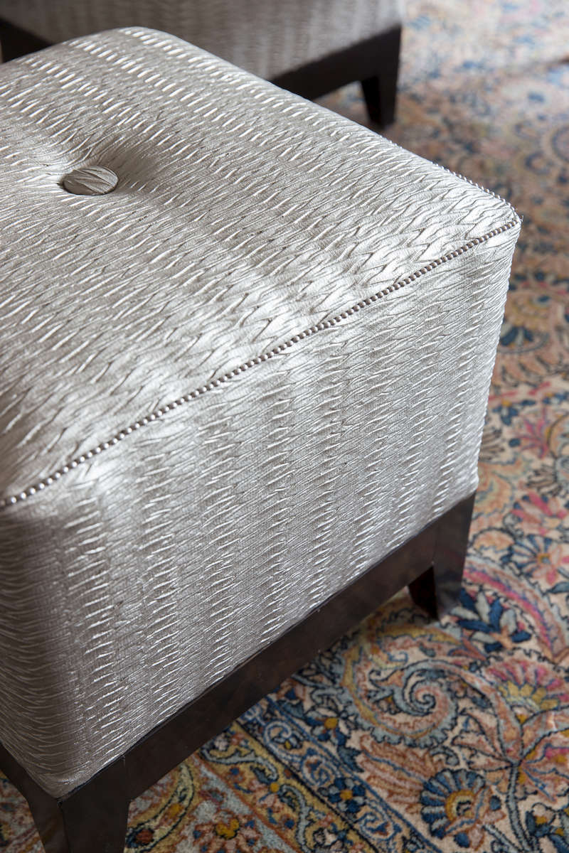 Re-upholstered button tufted ottoman