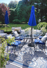 patio design with cobalt blue furniture and outdoor umbrella