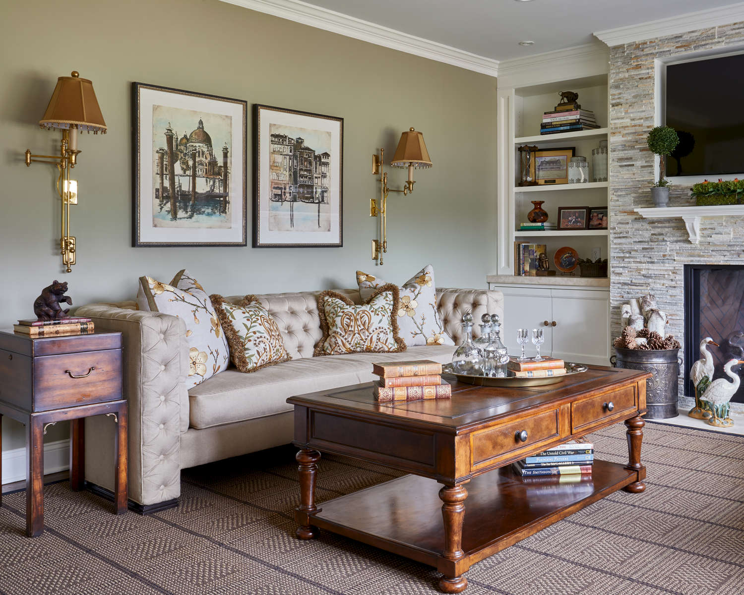 sage green family room with tufted sofa