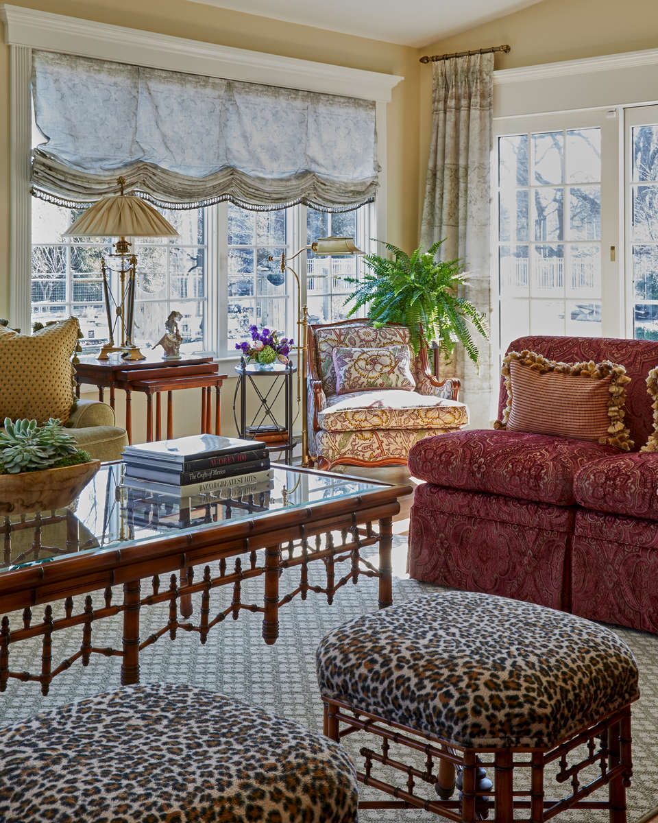 eclectic sunroom with soft flat roman shades