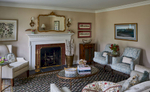 Formal living room with red brick surround fireplace