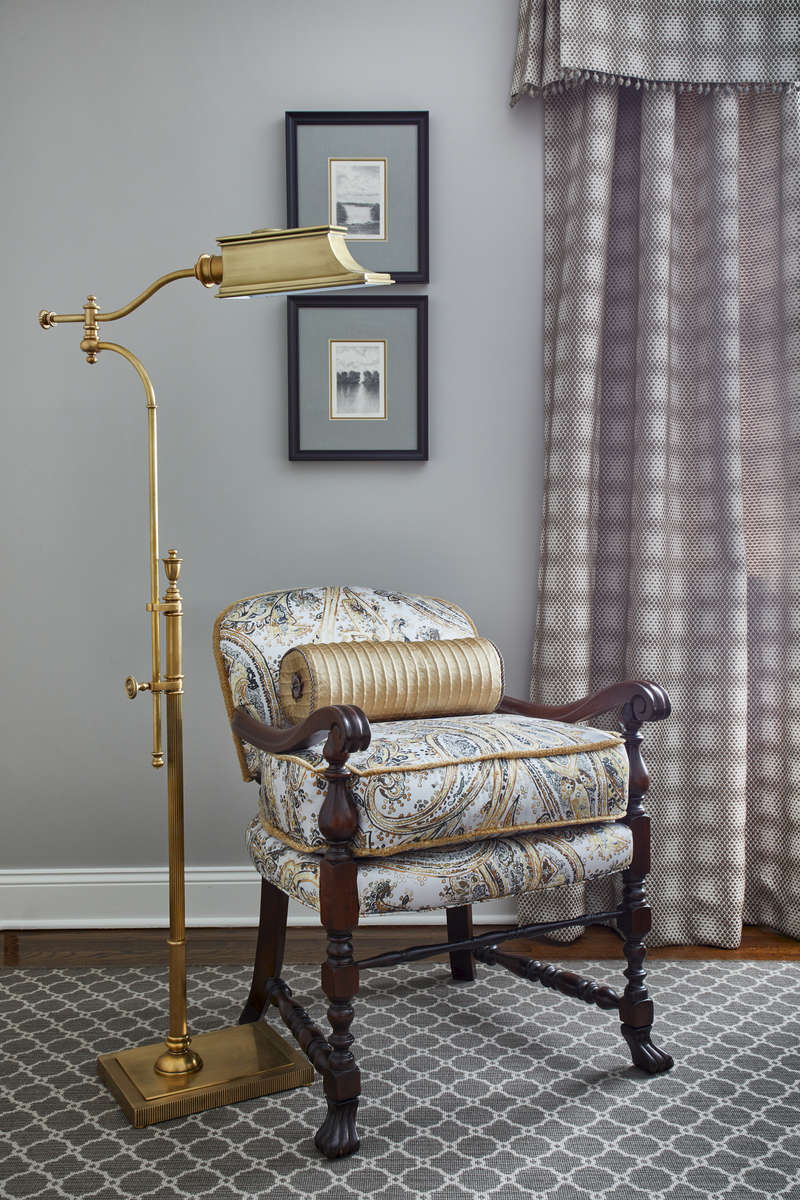 accent chair with brass floor lamp
