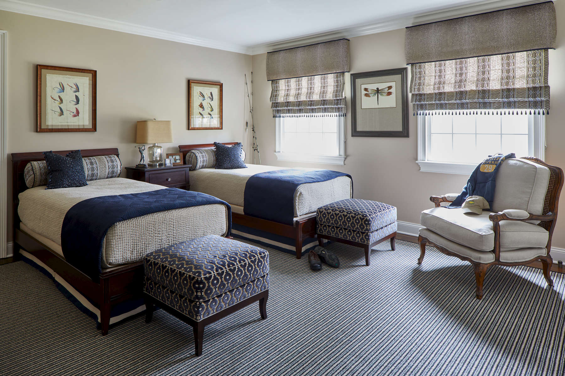 boys bedroom with twin beds in navy and taupe stanton burke midnight area rug