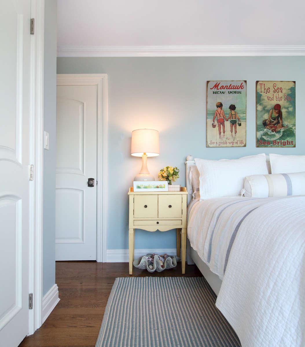 beach house bedroom with yellow nightstands