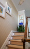 grasscloth wallcovering in the stairway