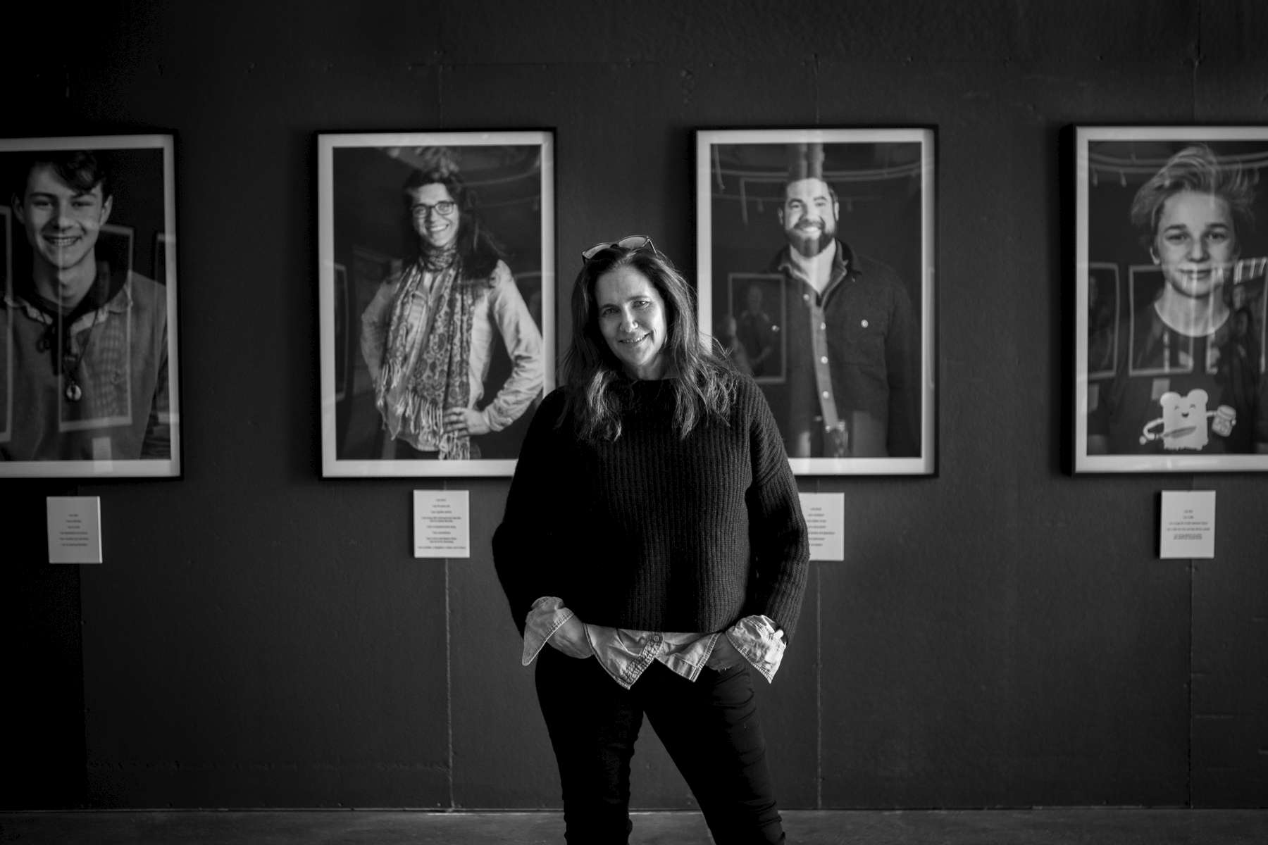 PORTLAND, MAINE -- 05/08/18 --  Portland photographer Lissy Thomas stands amid her work at Speedwell Projects on Forest Avenue. Her show {quote}I Am More: Facing Stigma{quote}  looks to put a face to mental illness. Troy R. Bennett | BDN