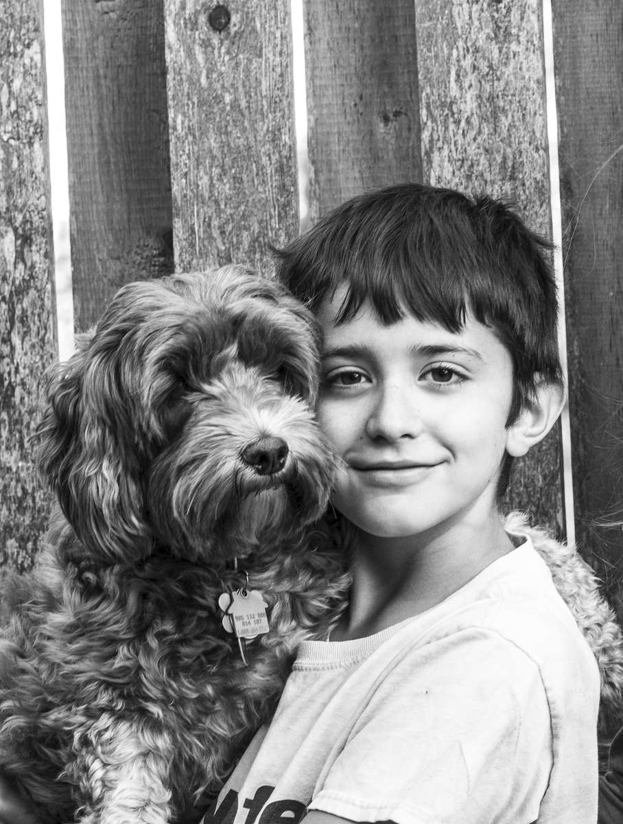 portrait of a boy and his dog