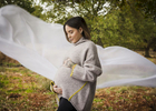 Outdoor photography of a pregnant lady with flowing fabric.