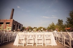 Table settings at an outdoor, abandoned factory wedding.