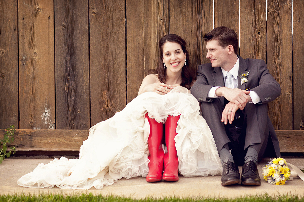 A bride in red rainboots at her Misty Farms, Ann Arbor Michigan wedding.