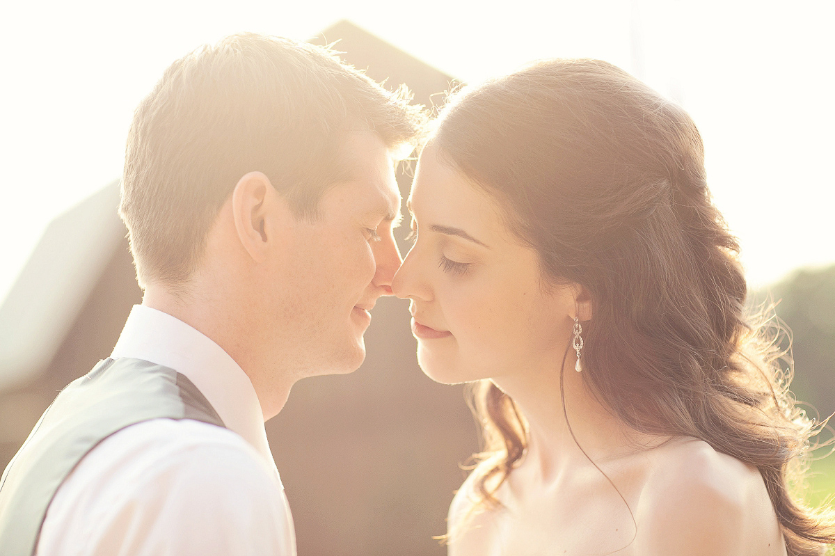 Glowy sunlight for a bride and groom's kiss at Misty Farms, Ann Arbor, Michigan.