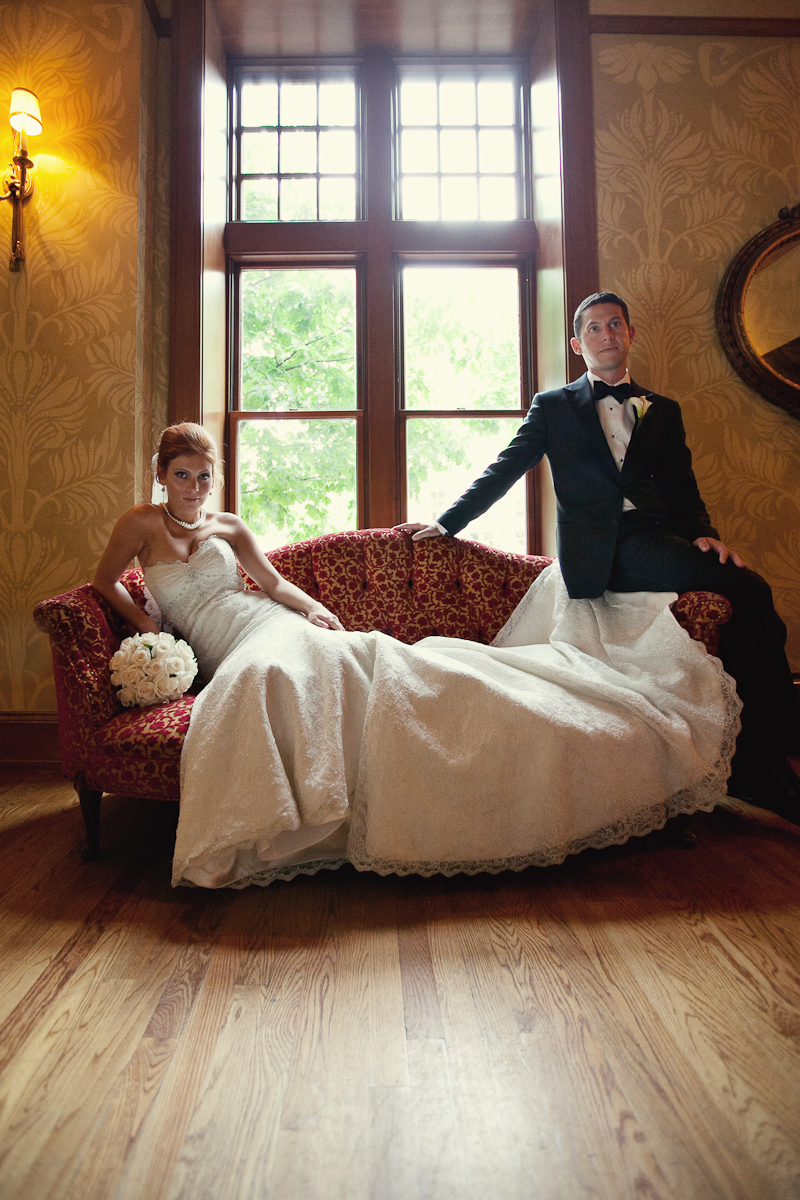 Bride and groom on a chaisse lounge at the Gem Theatre, Detroit Michigan.