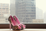 hot pink shoes in the window