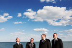 Groomsmen in front of Lake St. Claire at a Grosse Pointe War Memorial wedding.