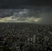 Sheets of rain bear down on the city from three converging typhoons.  Shinjuku, Tokyo, Japan.