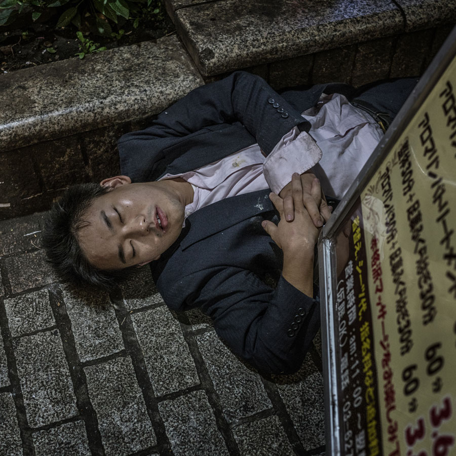 Passed out in the gutter.  Shibuya, Tokyo, Japan