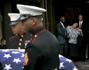 Carol Blanc, mother of Marine Lance Cpl. Leopold Damas who was killed in Afganistan, weeps as the flag-draped casket of her son was carried by United States Marines out of SS. Joachim and Anne Church in Queens, New York on August 29, 2009.