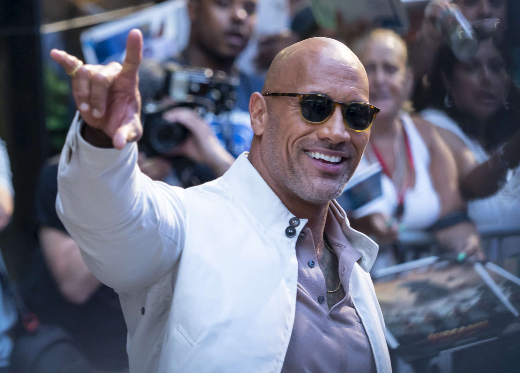 American actor, producer, and semi-retired wrestler Dwayne Johnson also known for his WWE name {quote}The Rock{quote} leaves ABC Studios at 1500 Broadway in Manhattan, New York on Tuesday, July 10, 2018.