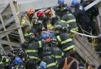 Firefighters rescue a survivor buried in the rubble after a crane collapse on a building located at 51st and 2nd Ave in Manhattan on March 15, 2008.