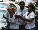 Shataiva Mills, 18, (left) is comforted by her mother after learning of the death of her fiance, Keywann Gardiner, who was killed with 4 other family members in a four-car pileup on the Bronx River Parkway on July 10, 2006.