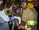 Emergency Medical Technician Tuanika Brown rescues a baby after a train derailment at St. Nicholas Avenue and West 135th Street in Harlem on Tuesday, June 27, 2017. Hundreds of people were evacuated and thirty four straphangers suffered non-life-threatening injuries.