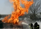 Firefighters battle the fire after a gasoline tank truck overturned and burst into flames at Van Wyck Expressway near North Conduit Avenue in Queens on March 03, 2008.