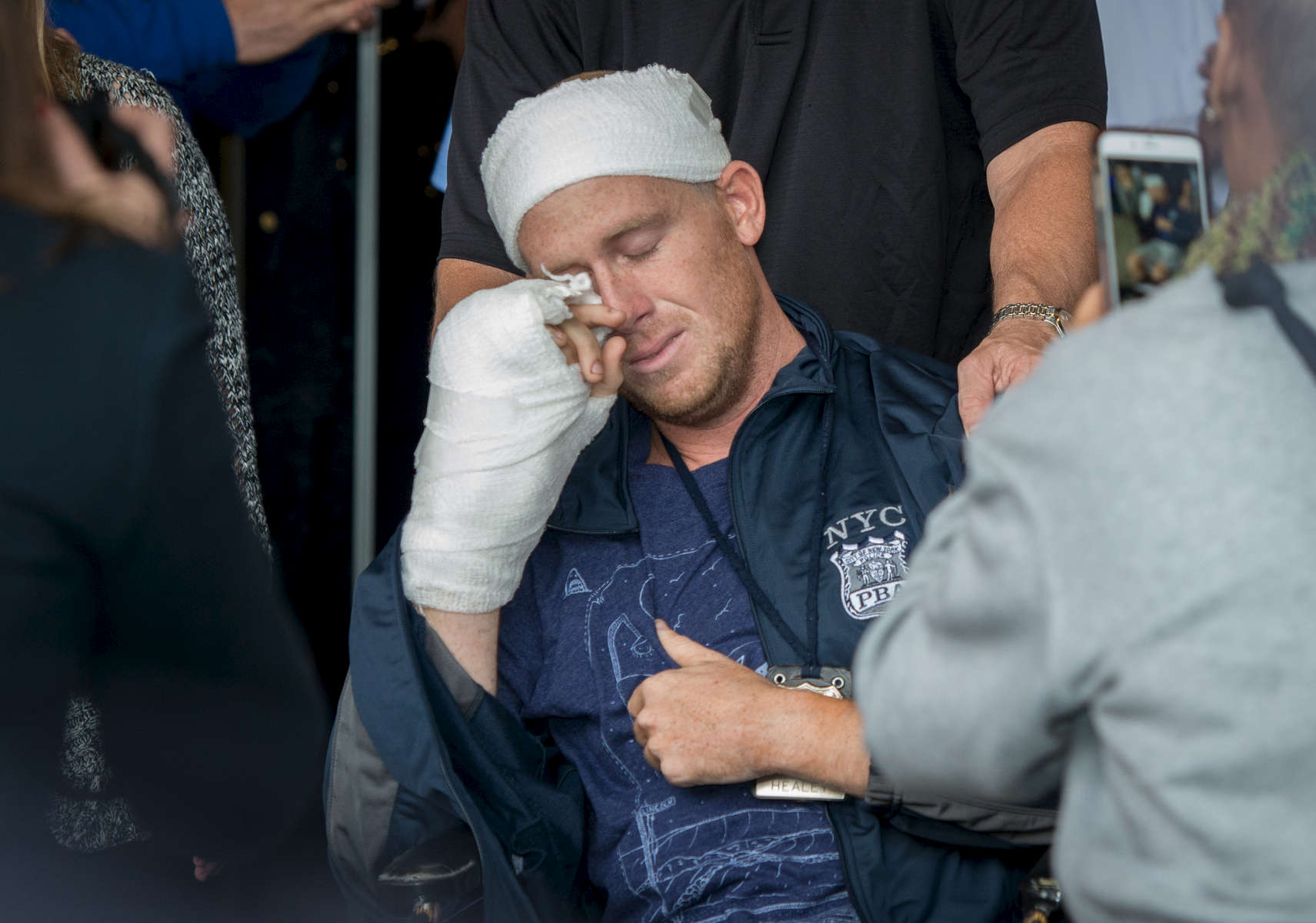 NYPD Police Officer Kenneth Healey, 25, who was brutally attacked in the head with a hatchet by Zale Thompson, an emotionally disturbed man, wipes his tears away as he is released from Jamaica Hospital Medical Center in Queens on Wednesday, October 29, 2014. He will be transferred to a rehab center.
