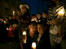 Thirteen people were killed after a gunman open fire inside American Civic Association before taking his own life in Binghamton, New York. Minh Nguyen, 38, and his son Henry, 6,  relative of Lan Ho, one of the 13 people who were killed, weep as they remember Lan at the candle light vigil held at West Junior High School at West Middle Avenue in Binghamton, New York on April 05, 2009.