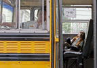 A young student, whose goes back to school for the first time after the break, takes some time to rest on his way to PS 143 in Corona, New York on Wednesday September 09, 2009.
