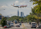 An American Airlines airplane flies over 23rd Avenue in Queens on Wednesday, September 10, 2014.