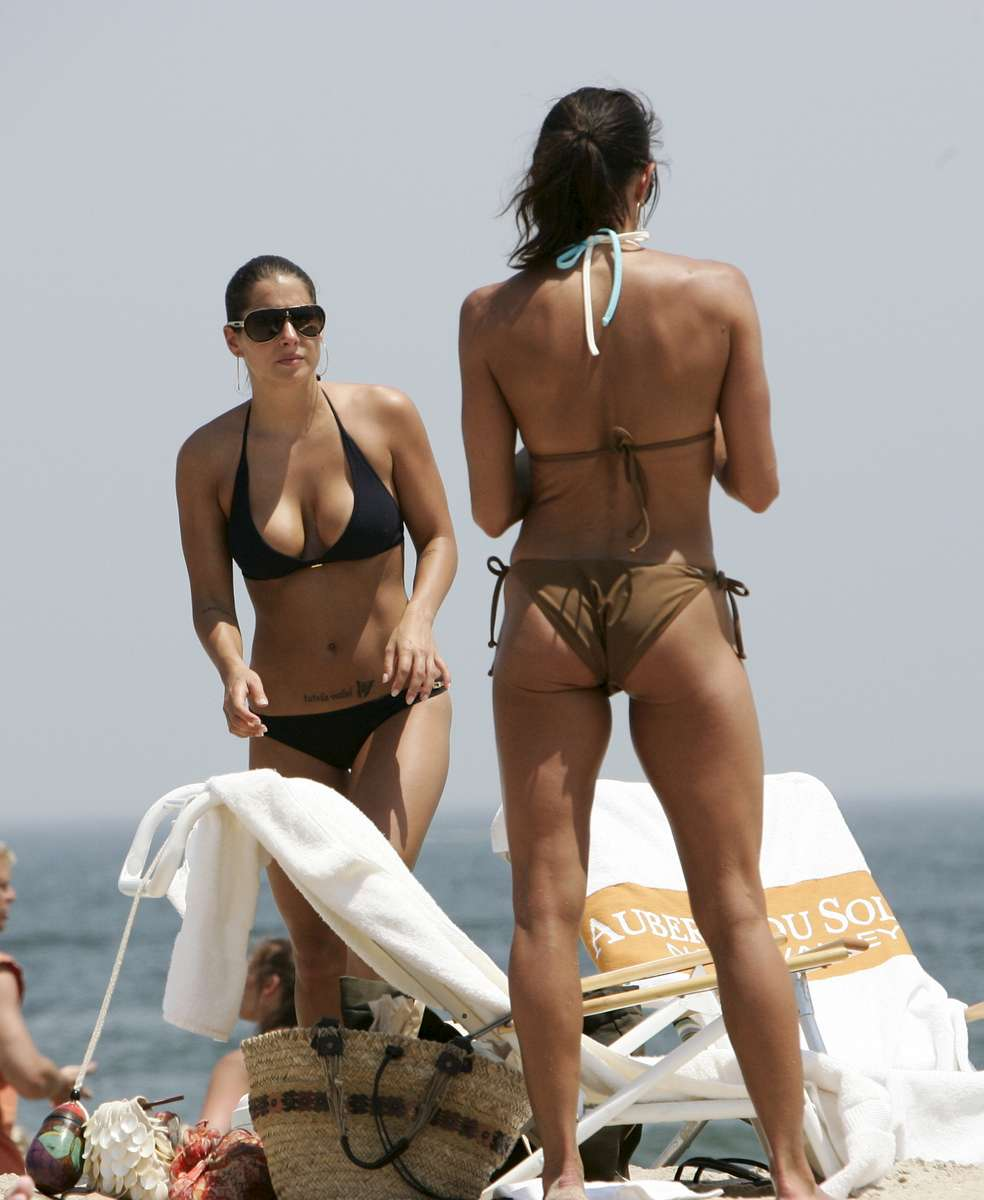 Ashley Alexandra Dupre (L), high-priced prostitute who includes former New York Governor Eliot Spitzer (client #9) as one of her clients, gets her tan as she hangs out with her mom 46-year-old Carolyn Capalbo at Sea Girt beach in Sea Girt, New Jersey on June 08, 2008.