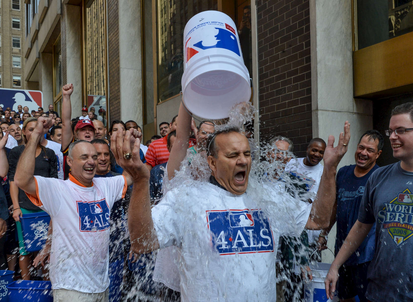 Former New York Yankees Manager Joe Torre along with MLB Commissioner Rob Manfred take on the ALS Ice Bucket Challenge in response to New York Daily News Mike Lupica's nomination, outside MLB headquarters at 245 Park Avenue in Manhattan on Wednesday, August 20, 2014.