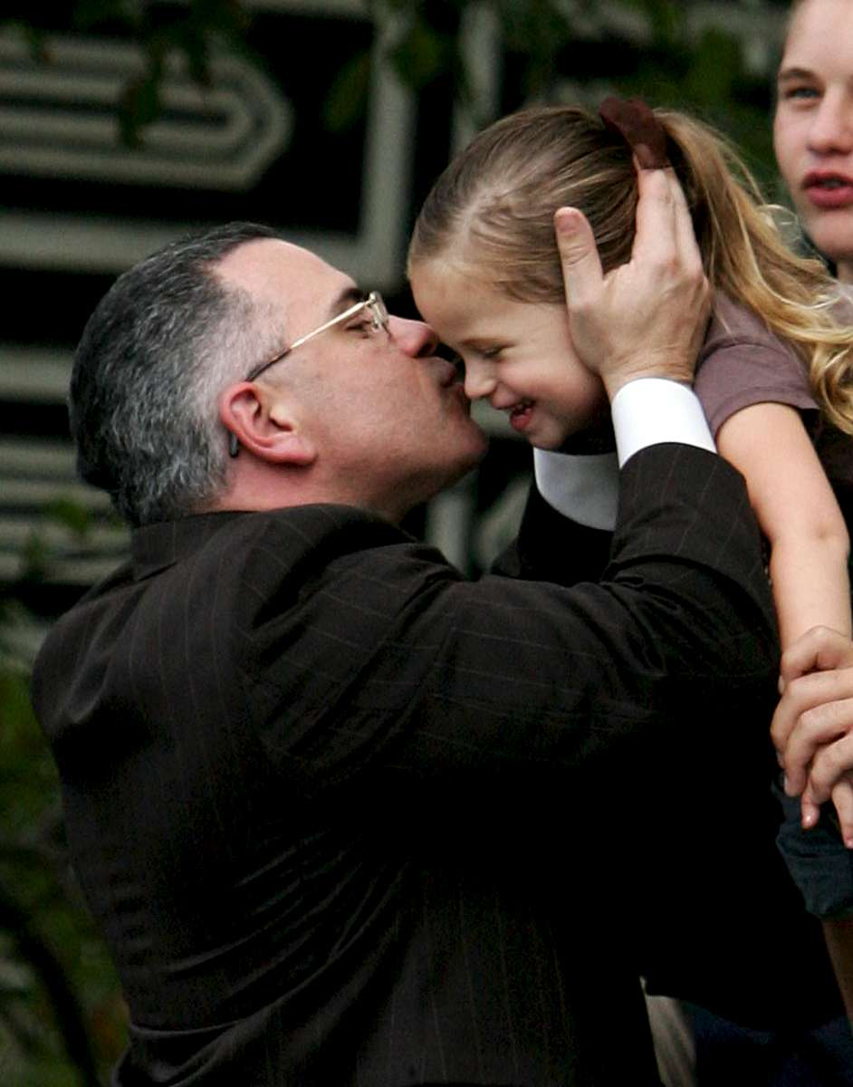 Mob scion John Gotti Jr., who appeared in court and gets his third mistrial for racketeering indictment, gives his niece Gabriela Gotti, 3, (his brother Peter Gotti's daughter) a kiss as he celebrates at his mother's home (Victoria Gotti) located at 160-11 85th Street in Queens on Wed. September 27, 2006.