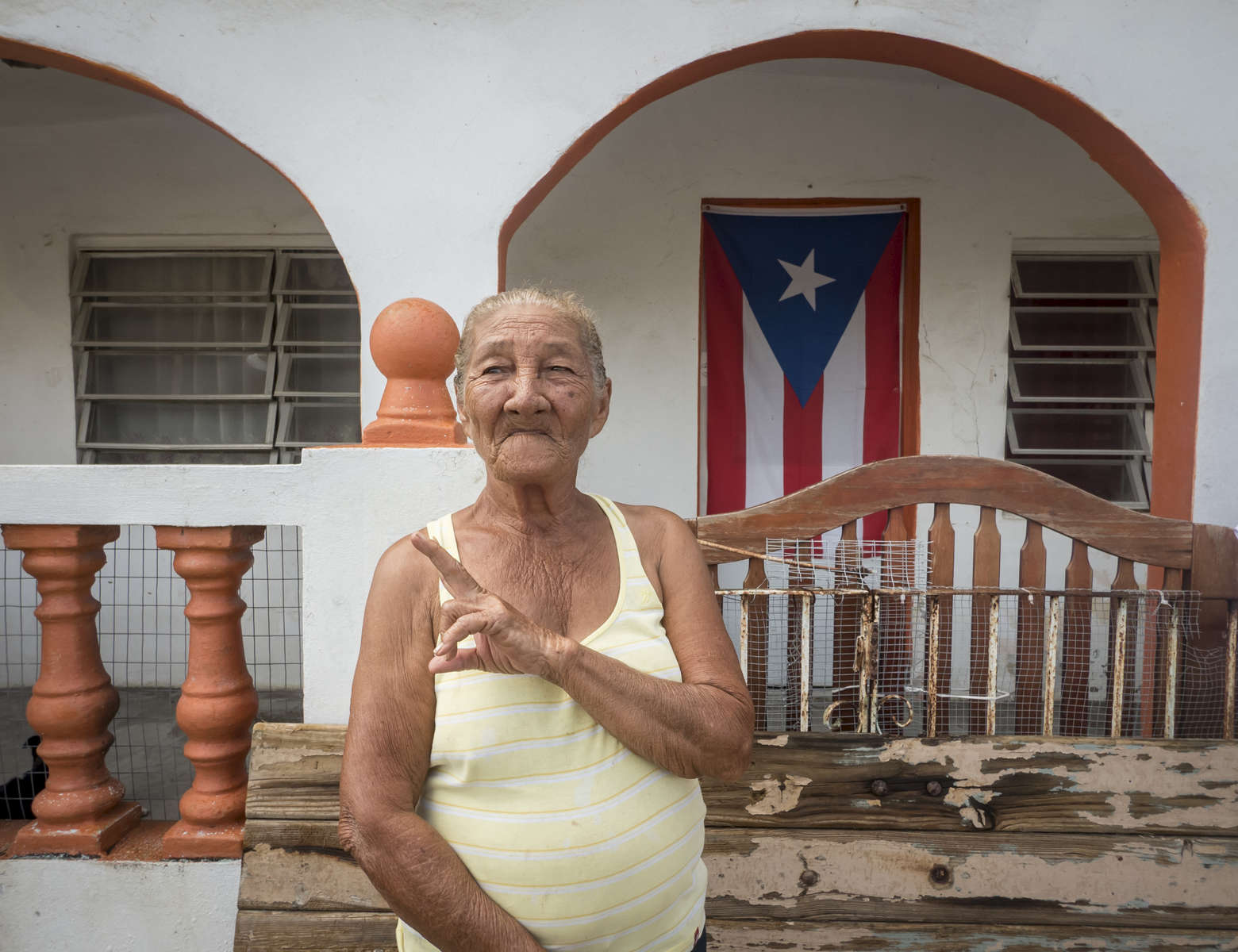 A hurricane victim stands outside her home at Las Mareas, Puerto Rico on Saturday, November 11, 2017. Hurricane Maria has wreaked havoc on September 20, causing a level of widespread destruction in the island of Puerto Rico. The category four hurricane left thousands hungry and homeless.