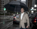 Lawyer Michael Cohen, who is the former lawyer of President Donald Trump, waits to get a taxi in front of Trump Park Avenue in Manhattan on Tuesday, September 25, 2018. He pleaded guilty to eight counts of campaign finance violations, tax fraud, and bank fraud. Michael Cohen was sentenced to three years in federal prison.