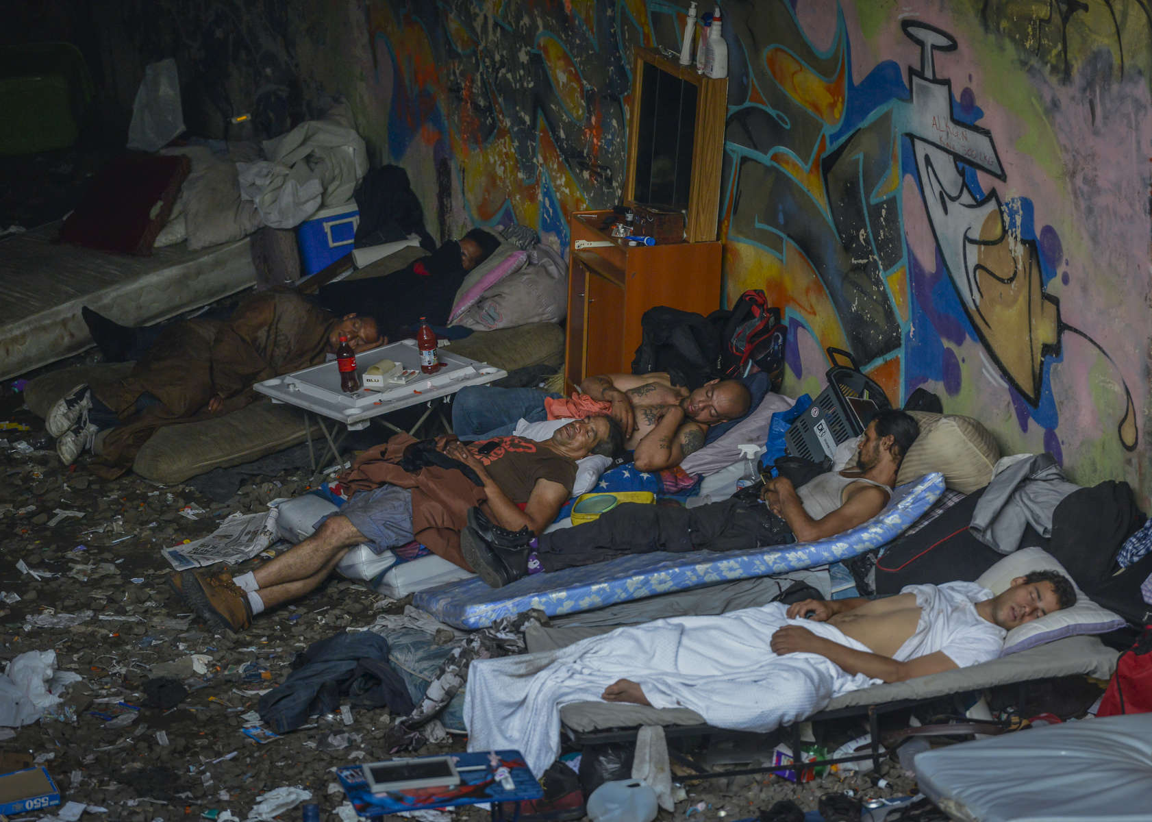 New Yorkers suffering from severe drug addiction and homelessness, sleep underneath an overpass in a space known as {quote}The Hole{quote} at the corner of St. Ann's Place and 150th Street in Mott Haven, the Bronx on September 3, 2015.  One day after Mayor de Blasio visited this South Bronx drug lair, Sanitation Department workers hauled out most of the addicts' piles of trash and the filthy furniture and dozens of syringes. As many as 20 men typically stayed at the site which has been a blight on the community for years.