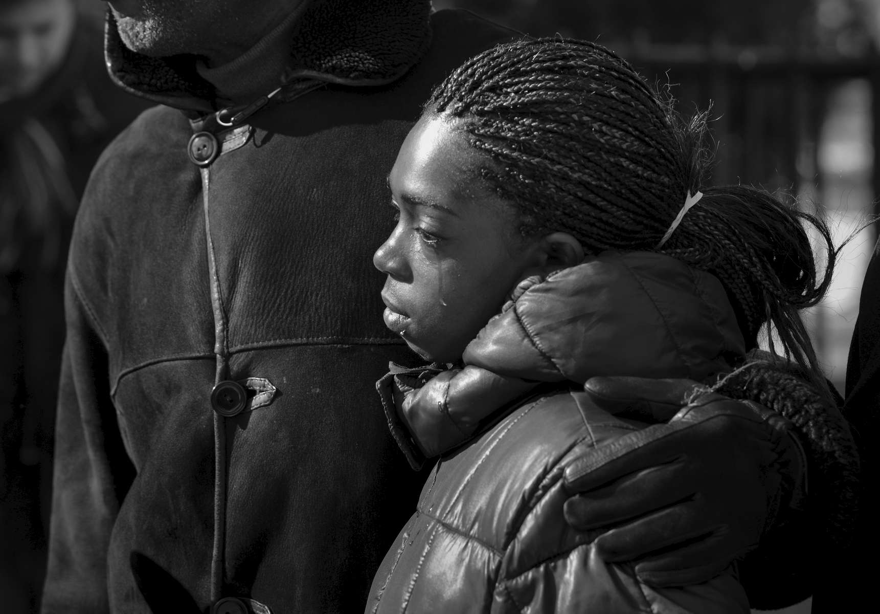 Tears flow on the cheeks of Melissa Butler, friend of Akai Gurley who was shot and killed by NYPD police officer Peter Liang at Louis Pink Houses. Melissa Butler, who was with Akai Gurley when he was shot and killed in the stairwell, was joined by her mother Naomi Butler, 69, daughter Janya Washington, 8, New York State Assembly Charles Barron, and her Attorney Rodger Wareham as they hold a news conference in response of the indictment of NYPD Officer Peter Liang at Louis Pink Houses located at 2632 Linden Boulevard in Brooklyn on Wednesday, February 11, 2015. Officer Liang is indicted and will face criminal charges for the fatal shooting.