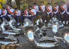 University of Virginia Marching Band members takes a rest along Central Park West during the Annual Macy's Thanksgiving Day Parade in Manhattan on Thursday, November 26, 2015.